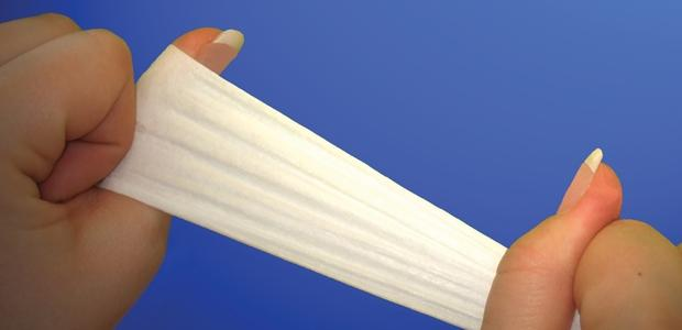 Extensible nonwoven for stretch components.